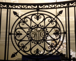 The wrought iron at the top of the stairs bears the logo of the Bank of New York. Photo copyright (c) 2016 Dianne L. Durante