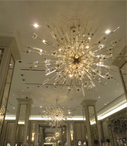 "Chandeliers in Berdorf's jewelry department - cousins to the Met Opera ""sputniks""."