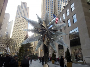 Swarovski crystal tree topper. Behind and to the left is the Rockefeller Center tree, topped by another Swarovski crystall doodah.